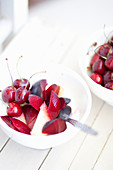 Yogurt with cherries and red plums