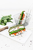 Sushi sandwiches with spinach, peppers, mange tout, black sesame seeds and peanuts (Japan)