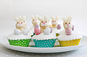 Easter cupcakes with marzipan bunnies and chocolate eggs