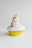 An Easter cupcake with a marzipan bunny and a chocolate egg