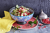 Oriental cucumber salad with pomegranate seeds and mint