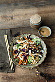 Thai chicken salad with cucumber and red cabbage