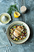 Fruity puy lentil salad with fish, mango and pomegranate seeds