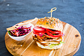 A schnitzel sandwich with pickled vegetables