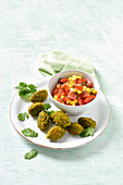 Yellow lentil falafels with a mango and tomato dip
