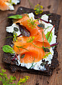 Smoked salmon and cream cheese and herbs on bread
