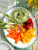 Creamy pesto hummus with raw veg sticks