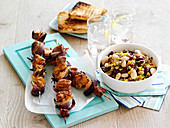 Pork kebabs with bean salad and toasted bread