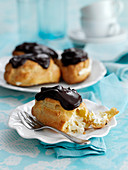 Eclairs topped with chocolate