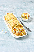 Almond roll with yoghurt and tangerine filling
