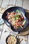 Thai konjac noodle salad with roast beef and peanuts