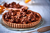 A chocolate and pumpkin tart topped with cornflakes