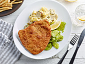 Wiener Schnitzel with potato and cucumber salad
