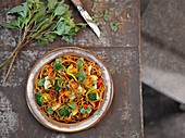 Egg and vegetable noodles with basil