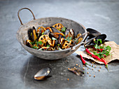 Sweet chilli mussels with sliced lotus root (Asia)