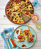 A colourful vegetable quiche and slices of leek quiche with bacon