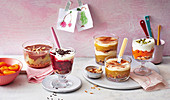 Pear and chocolate trifle, cherry and rice pudding trifle, apple and semolina trifle, and apricot trifle