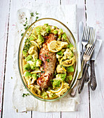 Roasted pork fillet with artichokes, capers and lemons
