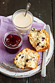 Blueberry muffin with jam and white coffee