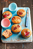 Muffins with chocolate and raspberries