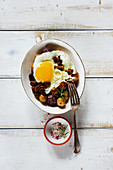 Fried egg, baby potatoes and mushrooms dinner bowl - healthy breakfast or snack