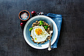 Quinoa, broccoli and egg over dark concrete background