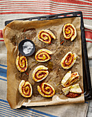 Pizza snails on a baking tray