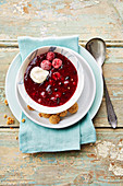 Cold berry compote with amaretti biscuits