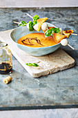 Cream of tomato soup with mozzarella skewers