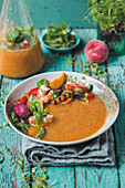 Summery peach and tomato soup with cucumber and paprika