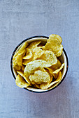Crisps in a vintage cup (seen from above)