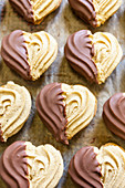 Heart shaped cookies dipped in chocolate