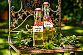 Homemade herb syrup in two bottles