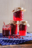 Jars of lingonberry compote and lingonberry jelly