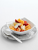 Strawberry and melon salad with ginger, honey, yoghurt and almonds
