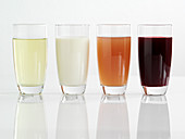 Chamomile tea, soy milk, aloe vera, and pomegranate juice in glasses