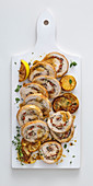 Rolled roast chicken stuffed with tapenade, ricotta and lemon