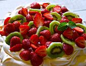 Pavlova with strawberries and kiwis