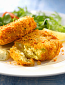 Breaded haddock cakes with salad
