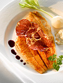 Plaice with prosciutto and truffle jus