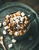 Winter warming sweet drink hot chocolate with marshmallows and cocoa in mug
