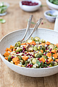 Roasted sweet potato salad with brussels sprouts and pomegranate seeds