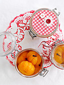 Pickled clementines in glass jars
