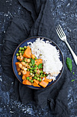 Thai vegan curry made with chickpeas, green peas and sweet potato