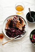 Grilled pork ribs cooked with balsamic vinegar and honey sauce, garnished with red wine braised red cabbage with beets