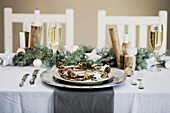 Holiday celebration table setting, white, gold and silver christmas table setting