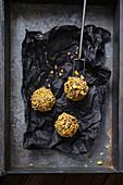 Matcha and marzipan balls, coated in cornflakes (vegan)