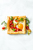 A vegetable tart with a fried egg for breakfast