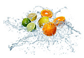 Citrus fruits in a splash of water