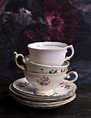 Three vinatge fine bone china tea cups and saucers stacked